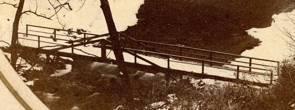 a close up of the first bridge, with intact railings.