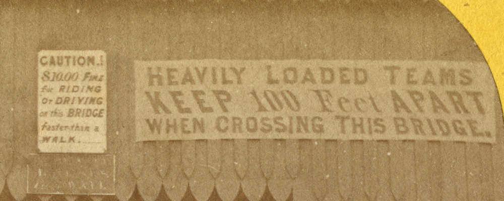 A sign on the first bridge across the Mississippi, warning that heavy teams cross with 100 feet of distance between them.